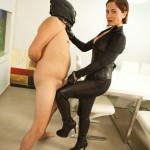 Masked naked dude getting humiliated and jeered by hot mistress in leather suit
