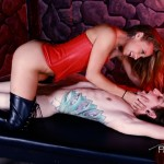 Cute girl in red subdues and fucks guy with tattoo with hands tied cowgirl style