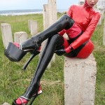 Slim and tall babe posing in red and black latex