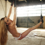 Virginal blonde tightly ball gagged and securely bound in spreader bar and neck bar