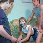 Pretty chick bound and gag-balled by four rude guys