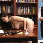 This randy brunette gets her juicy ass spanked in the library.